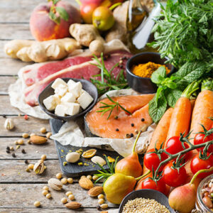 An array of healthy, nutrient-dense foods including seafood, fruits, and vegetables.